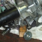 A bit blurry this picture but you can get an idea of the use of the engine mount extractor, to remove....